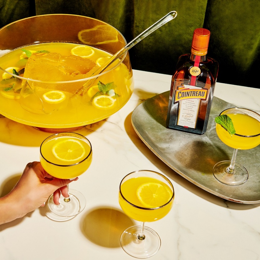 Coupe of Gold Batch Cocktail with Cointreau